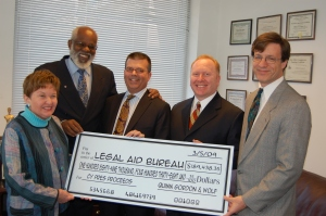 Wilhelm Joseph accepting a $189,000 cy pres award from Martin Wolf, Richard Gordon and Paul Bland